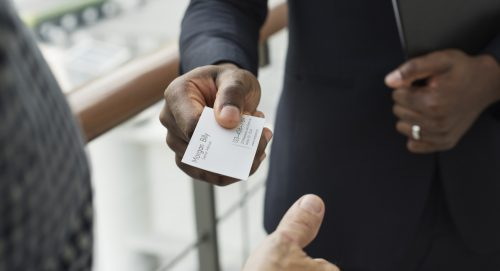 Two People Exchanging Business Cards