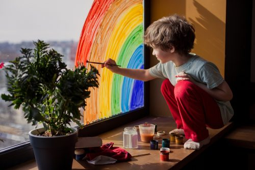 Community - Child Painting a Rainbow