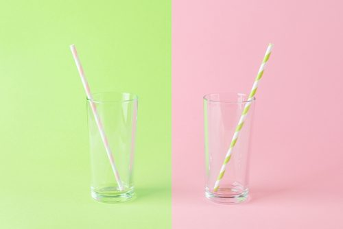 Empty,Tall,Glass,With,A,Pink,Paper,Drinking,Straw,On