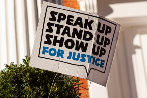 speak up, stand up, show up for justice sign